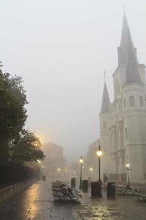 louisiana: Early morning fog on Jackson square obscures St. Louis Cathedral in New Orleans, Louisiana
