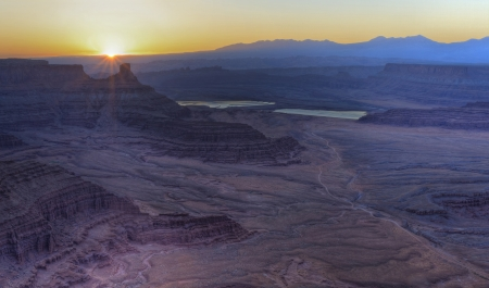 mesas: Spectacular sunrise over the purple mesas and and potash ponds seen from Dead Horse Point Overlook in Dead Horse Point State Park, UT