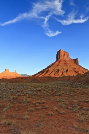 Partt Mesa rises from the desert under a bird-like cloud formation near Moab, Utah Stock Photo - 15876014