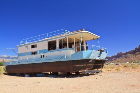 Rusty houseboat stranded in the desert near Moab, Utah Stock Photo - 15876018