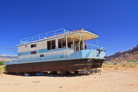 Rusty houseboat stranded in the desert near Moab, Utah Stock Photo - 15876018