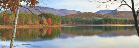 cooper: The first soft rays of Autumn sun hit the trees on the far shore of Cooper Lake near Woodstock, NY