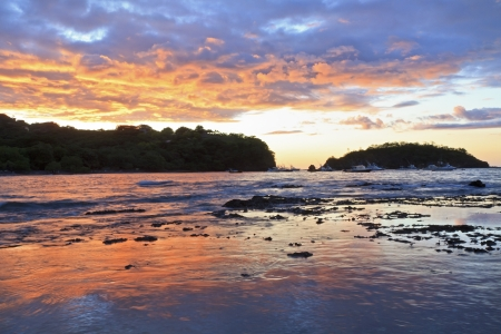 Sunset behind Punta Gorda on Playa Ocotal on the Pacific Ocean in Guanacaste, Costa Rica