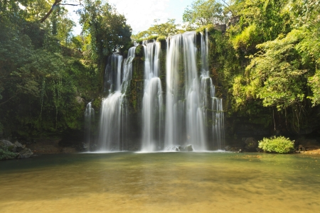 A popular picnic spot and swimming hole -  Llano de Cortes waterfall near Bagaces, Costa Rica Stok Fotoğraf