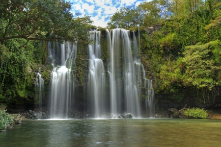 HDR image of the gorgeous swimming hole and falls at Llano de Cortes waterfall near Bagaces, Costa Rica