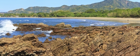 Panoramic photo of Playa Conchal from the rocky point offshore near Brasilitio, Costa Rica