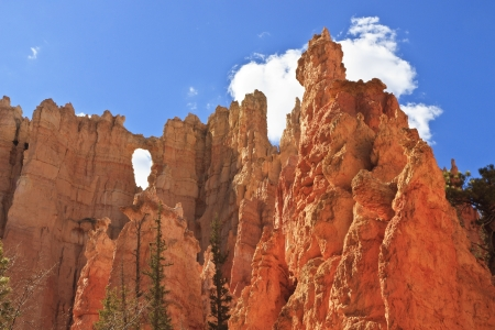 ridgeline: A window opening in a cliffwall of hoodoos at the Wall of Windows in Bryce Canyon National Park, Utah