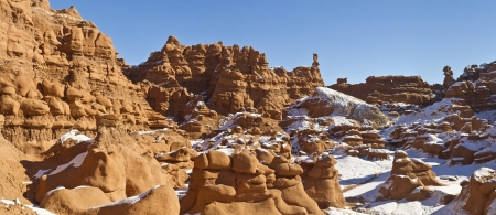 goblins: Goblins line the snowy cliffs in Goblin Valley State Park, Utah