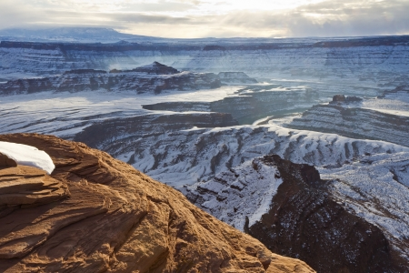overlook: Wintry view of Pyramid Butte and the Colorado River from an overlook in Dead Horse Point State Park Utah.