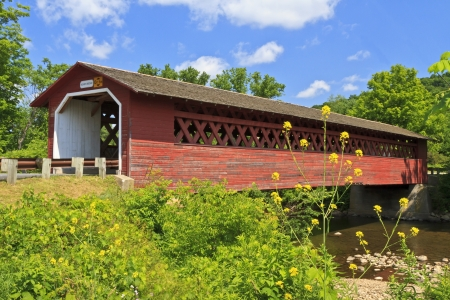 Historic Henry Covered bridge over the Walloomsac River e in Bennington, Vermont