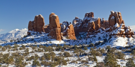 A snow-covered mound of red rock fins in the Windows section of Arches National Park in Utah