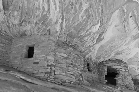 grainery: The House on Fire Anasazi ruins in Mule Canyon in the Cedar Mesa Plateau of Utah look like the ancient stone granaries and dwellings are on fire.
