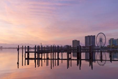 pensacola: Sunrise on the Pensacola Beach ferris wheel on Santa Rosa Sound in Pensacola Beach, Florida