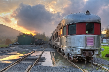 Panoramic image of the Delaware & Ulster Railroad Rip Van Winkle Flyer as a storm clears at sunset, in Arkville, NY photo