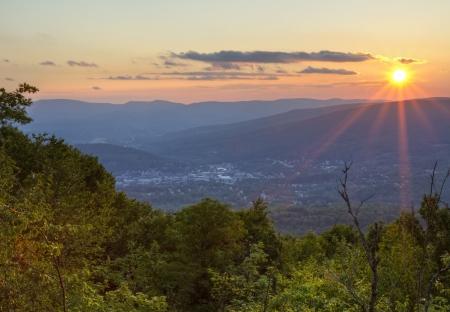adams: A Summer sunset overlooking North Adams, Masachusetts in the Berkshires. Stock Photo
