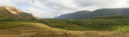 morne: View of the Tablelands and cliffs lining foggy Trout River Pond valley in Gros Morne National Park, Newfoundland
