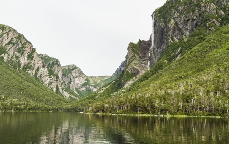 Jagged, tree-covered cliffs at the end of Western Brook Pond in Gros Morne National Park, Newfoundland and Labrador photo
