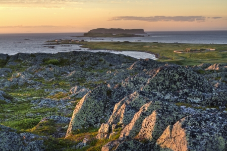 aux: Sunset seen from a rocky hill overlooking the Viking settlement   at L Stock Photo