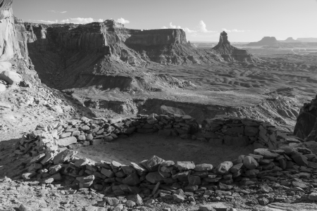 Black and White image of  False Kiva  class 2 archaeological site in Canyonlands National Park, with a view of Candlestick Tower in the Background photo