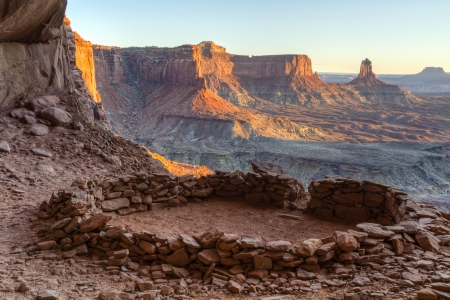kiva: So-called  False Kiva  class 2 archaeological site in Canyonlands National Park, with a view of Candlestick Tower in the Background Stock Photo
