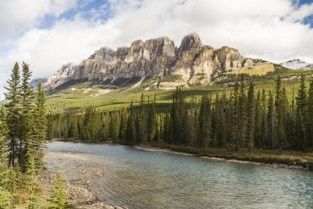 Castle Mountain emerges from the clouds above the Bow River in Banff National Park, Alberta photo