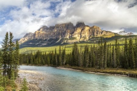 Castle Mountain emerges from the clouds above the Bow River in Banff National Park, Alberta  HDR  photo