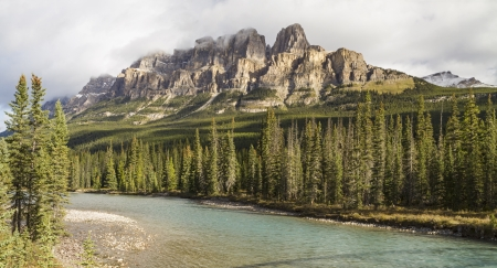 eisenhower: Mountain emerges from the clouds above the Bow River in Banff National Park, Alberta  Panorama