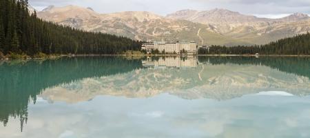 ski runs: Chateau Lake Louise and the Lake Louise Ski runs reflected in the lake in Banff National Park, Alberta