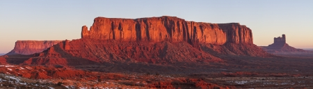 tribal park: Red sunrise On Sentinal   Eagle Mesas and Big Indian Butte in Monument Vally Navajo Tribal Park on the Arizona-Utah border