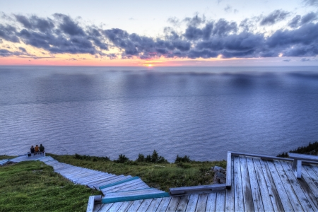 boardwalk trail: Clouds over the Gulf of St  Lawrence from the boardwalk on the Skyline Trail at sunset in Cape Breton Highlands National Park, Nova Scotia Stock Photo
