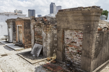 Row of crumbling brick tombs in St  Louis Cemetery in the Treme district of New Orleans photo