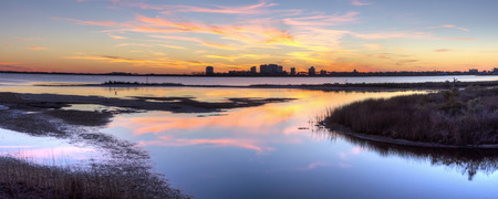 perdido: A colorful sunset reflected in the inlet at Big lagoon State Park, with Perdido Key, Florida