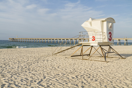 pensacola beach: A lifeguard station and the fishing pier in the early morning on Pensacola Beach, Florida  Stock Photo