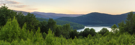 Panoramic view of the Pepacton Reservoir and Catskills Mountains at sunset from the Shaverton Trail overlook  in Andes, New York