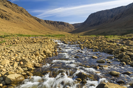 Winter House Brook flows out of a glacially carved peridotite canyon in the Tablelands section of Gros Morne National Park, Newfoundland