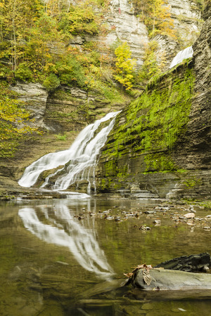 lower section: The lower section of Lucifer Falls in Autumn seen from the creek in Robert H. Treman State Park in Trumansburg, New York
