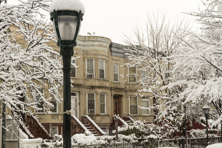 February 2014 snowstorm on the stoops of historic Brownstone apartments on Eastern Parkway in Crown Heights, Brooklyn photo