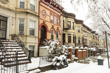 Snow on the stoops of historic Brownstone apartments on New York Avenue in Crown Heights, Brooklyn photo