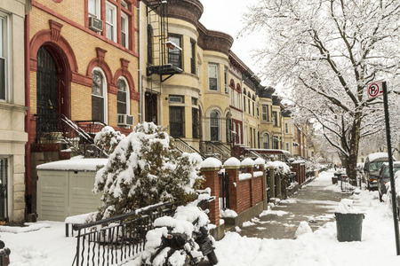 Snow on the stoops of historic Brownstone apartments on New York Avenue in Crown Heights, Brooklyn