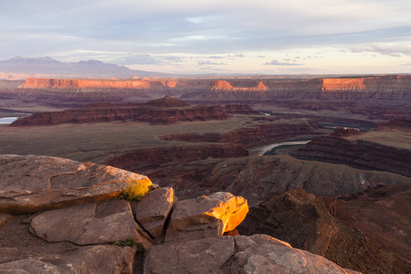 overlook: Expansive view of the last rays of sun on the Canyons of the Colorado River seen from Utah