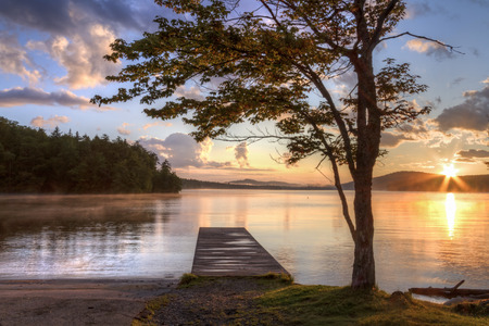 seventh: Sunset on the shore of Seventh Lake in the Fulton Chain Lakes region of the Adirondack Mountains of New York Stock Photo