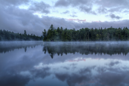 seventh: Foggy morning on  Seventh Lake in the Fulton Chain Lakes region of the Adirondack Mountains of New York Stock Photo