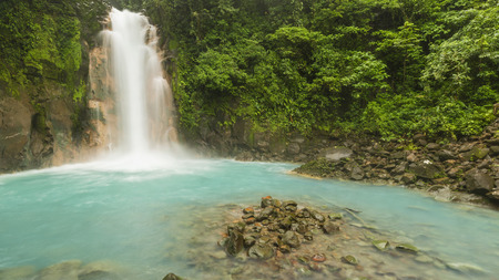 mountain oasis: Panoramic image of the cerulean blue waters of the Rio Celste Waterfall in Volcan Tenoria National Park, Costa Rica. Stock Photo