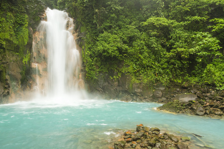 mountain oasis: The cerulean blue waters of the Rio Celeste Waterfall in Volcan Tenorio National Park, Costa Rica.
