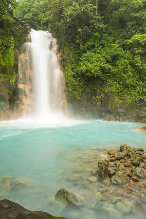celeste: The cerulean blue waters of the Rio Celeste Waterfall in Volcan Tenorio National Park, Costa Rica.