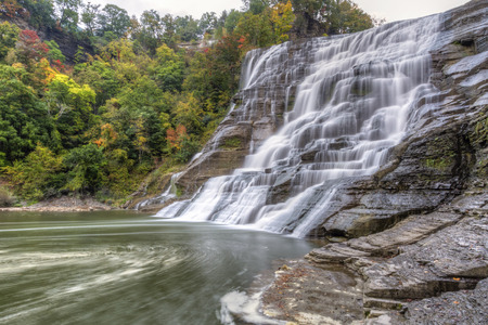 swirling: Swirling foam below powerful Ithaca Falls on Fall Creek, near the Cornell Campus in Ithaca, New York