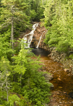 north cascade national park: Mary Ann Falls and Brook winds through the forest, seen from an overlook in Cape Breton Highlands National Park, Nova Scotia Stock Photo
