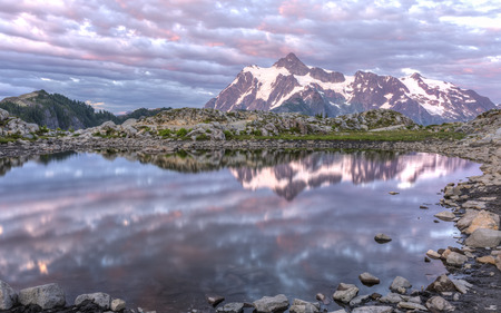national forest: Mt Shuksan and colorful sunset clouds reflected in a tarn on Artist Ridge in Mt. Baker-Snoqualmie National Forest, Washington.