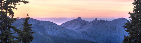 vancouver island: A sunset panorama looking North From Hurricane Ridge over Unicorn Peak toward the foggy Strait of Juan de Fuca and Vancouver Island in Olympic National Park, WA