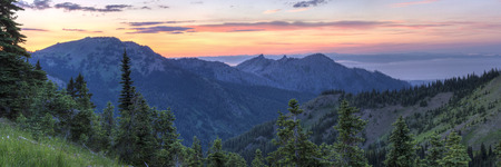 strait of juan de fuca: A sunset panorama looking North From Hurricane Ridge over Hurricane Hill, Unicorn Peak and Mt., Angeles toward the foggy Strait of Juan de Fuca in Olympic National Park, WA
